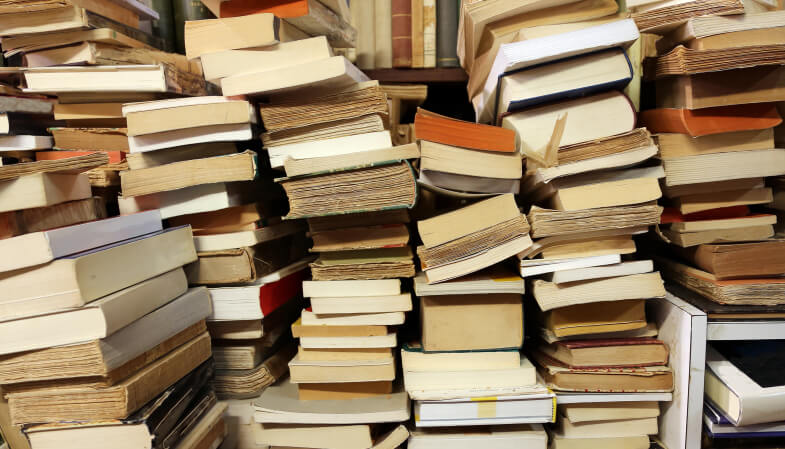 books piled up for sale in the great library