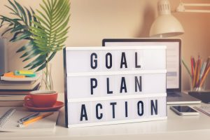 Goal, plan, action text on light box on desk table in home office.Business motivation or inspiration,performance of human concepts ideas